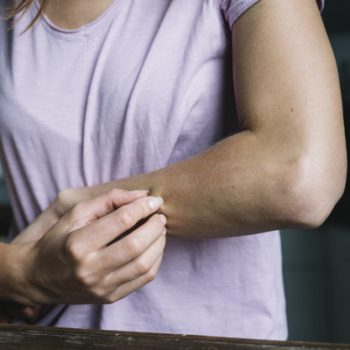 close-up-woman-pinching-her-arm_23-2147953200