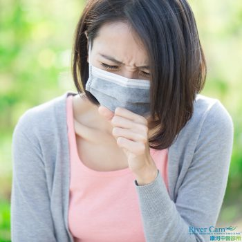 woman get sick and cough in the forest