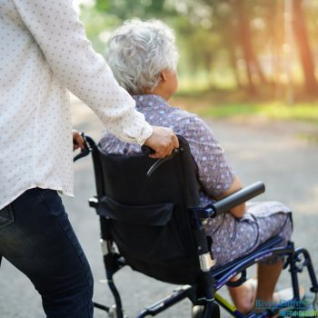 Asian senior or elderly old lady woman patient with care, help and support on wheelchair in park in holiday: healthy strong medical concept.